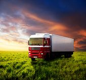 field of grass in sunset and truck