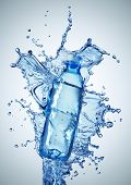 foto of bottle water  - Bottle with pure water and splash around it - JPG