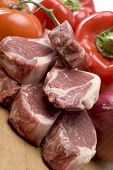 picture of lamb chops  - rib lamb chops meat prime cut with vegetables on cutting board - JPG