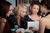 picture of foursome  - Four young female students study at a cafe - JPG