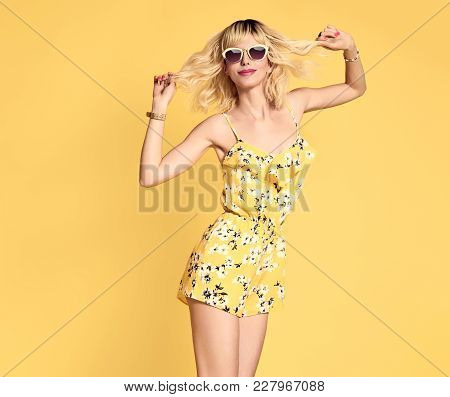 poster of Short-haired Girl In Fashionable Sunglasses Dancing. Young Playful Female Blond Model In Stylish Fas