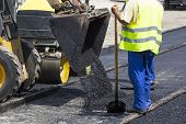 Worker Construct Asphalt Road And Railroad Lines poster