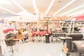 Blurred Grills And Outdoor Cooking Tools At Sporting Goods Store In America poster