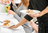 Waiter serving tasty dishes at restaurant poster