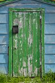 Closeup Of An Old Green-doored Fishing Shed