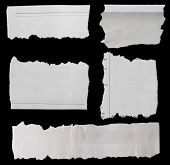 Pieces of torn paper on black poster