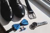 Black Leather Shoes And Belt, Watch, Blue Bow Tie And Cufflinks, On A White Window Sill. Accessory F poster