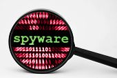 pic of spyware  - Close up of spyware concept over binary data background - JPG
