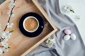 Cup Of Coffee Espresso, Colorful Chocolate Eggs And Cherry Blossom On Wooden Tray On White Shabby Ch poster