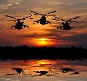 militant helicopter mi-24 silhouette in sunrise