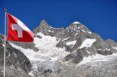 Beautiful mountain Ober Gabelhorn with Swiss flag - Swiss Alps