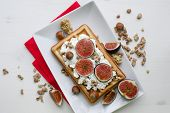 Vienna Wafer Dessert With Ricotta, Nuts And Fresh Figs On White Plate Over Wooden Background, Health poster