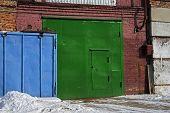 Green Garage Door. Metal Door. Green Door. poster