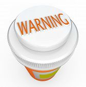 A white child-proof medicine bottle cap features the word Warning to caution you of dangerous side effects or the hazards of children or other loved ones taking pills not intended for them