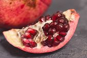 Close Up Granate Seeds In Slice. Pomegranate Slice Fruit. Diet, Vitamine And Health Concept poster