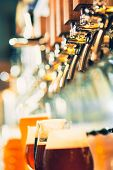 The Beer Taps In A Pub. Nobody. Selective Focus. Alcohol Concept. Vintage Style. Beer Craft. Bar Tab poster