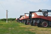Combine Harvesters, Standing In A Row. Agricultural Machinery. Parking Of Agricultural Machinery. poster