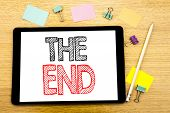 Writing Text Showing The End. Business Concept For End Finish Close Written On Tablet, Wooden Backgr poster