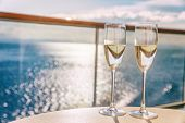 Luxury cruise ship travel champagne glasses on balcony deck with ocean sunset view on Caribbean vaca poster