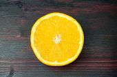 Juicy Orange Cut In Half To Make Orange Juice For Breakfast. Juicy Orange Cut In Half To Make Orange poster