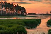 Sunset In The Marshes Of Chincoteague National Wildlife Refuge In Virginia poster