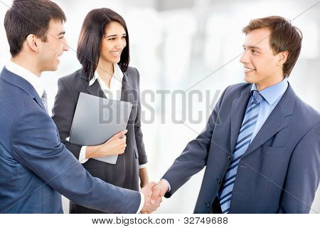 Business people shaking hands finishing