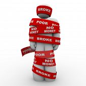 A person is wrapped in tape marked with the words Broke, Poor, and No Money, symbolizing being finan