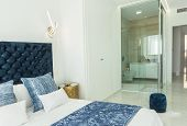 Fragment Of Modern Bedroom In Minimalist White And Blue Interior Design Style With Peek A Boo Transp poster