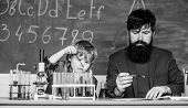 Teacher Man With Little Boy. School Lab Equipment. Back To School. Father And Son At School. Using M poster
