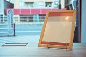 Blank Mock Up Or Label Menu Frame Advertising In Restaurant, Stand For Booklets White Paper Sheets A poster
