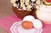 Easter eggs and spring flowers on background