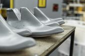 Plastic Lasts Used In The Manufacture Of Shoes. Row Of Plastic Shoe Lasts Used To Manufacture Modern poster