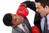 image of adversity humor  - Two businessmen boxing - JPG