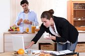 picture of concubine  - Woman working while eating breakfast - JPG