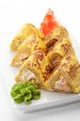 Omelet Maki Sushi - Roll made of Salmon and Cream Cheese  inside. Tamago (Japanese Omelet) outside