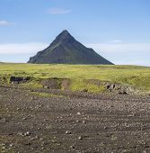 Volcanic Landscape With Green Storasula Mountain, Hills And Lava Gravel Ground Covered By Lush Moss. poster