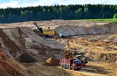 Wheel Front-end Loader Loads Sand Into A Dump Truck. Heavy Machinery In The Mining Quarry, Excavator poster