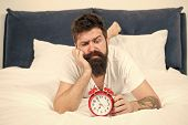 Depressed Man In Bed. Time Management. Tired Bearded Man Hipster With Alarm Clock. Brutal Sleepy Man poster