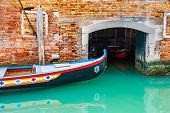Old Venetian Gondola On The Canal In Venice, Italy. Garage For Boats On The Canal poster