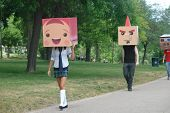 People Walking With Box Heads