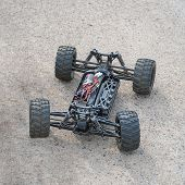Disassembled Rc Model Racing Cars. Model Cars Without Top. Radio Controlled Car Model Frame poster