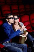 stock photo of movie theater  - A couple in a movie theater - JPG