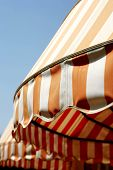 pic of awning  - summer sun protection window awnings isolated clear blue sky - JPG