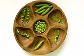 picture of mange-toute  - Fresh green peas in vintage wooden bowl - JPG