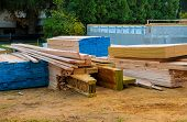 Stacked Wooden Building Materials A Stack Of Boards Wood Frame Beam Construction poster