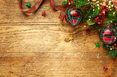 Christmas background with Christmas baubles, branches of holly and fir on wooden background. Winter  poster