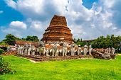 Ruin Bell-shaped Chedi Surrounded By Lions At Wat Thammikarat Buddhist Temple In Phra Nakhon Si Ayut poster