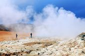 Tourists visiting the geothermal region of Hverir in Iceland near Myvatn Lake, Iceland, Europe poster