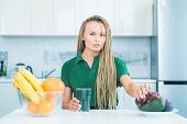 Vegetarian Diet Trend. Smiling Young Woman Drinking Green Smoothie In Kitchen. Green Juice. Vegan Me poster