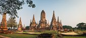 Tourists Visit Wat Chai Watthana Ram Temple Located In The Historic District Of Ayutthaya, Thailand. poster